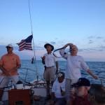 Guests steering the schooner with Captain looking on