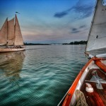 Rippled green waters and sunset sky with both schooners