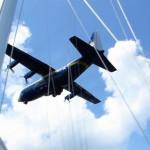 USNA Fat Albert plane flying over the schooner