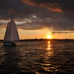 Sunset and clouds over Annapolis with schooner sailing into them
