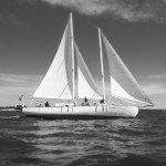 Schooner in a black and white photograph under full sail