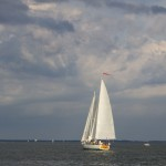 Full shot of the schooner under full sail on a cloudy day