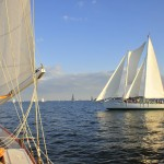 Picture from one schooner to another sailing on a sunny blue day