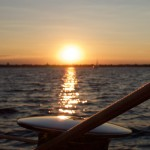 The winch on the schooner shinning in the golden sunset