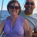 Couple smiling and having fun on a schooner sail