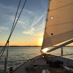 Gentle breeze blowing the sails into a beautiful sunset on the schooner