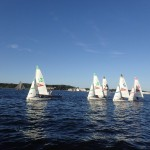 Future sailors on colorful sailboats learning the ropes