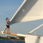 Captain Jen hanging onto the foremast and standing on the bowsprit
