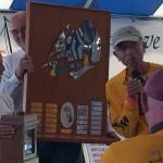 Schooner Woodwind owners being presented trophy for The Great Chesapeake Bay Schooner Race
