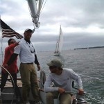 Captains on schooner working together with crew to win a race