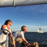 Taking a picture from one schooner to another on a sunny sail day