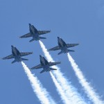 The USNA Blue Angels flying in a clear blue sky
