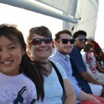 Guests all smiling on a sail on the Chesapeake Bay