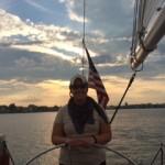 Steering the sailboat at dusk
