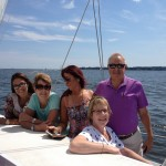 Family of five enjoying a sunny day sail on the Chesapeake Bay