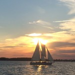 Blue yellow and pink sunset over the schooner sailing on the bay