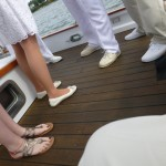 Picture of feet on the deck of bride and groom getting married