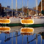 Two Woodwind Schooners side by side docked and reflecting in water