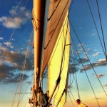 Beautiful gold and blue sunset reflecting off of sails