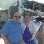 Man and women on sunset sail