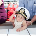 Baby girl that was a flower girl with Captains lid on