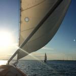 Front of Schooner looking at the other schooner sailing sun slanting down