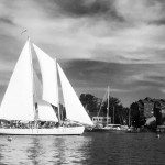 Dramatic black and white picture of the schooner and landscape behind it