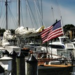 Sails down on schooner and docked in port