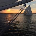 Picture taken from under the jib of one schooner of other schooner sailing