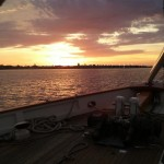 Sunset over Annapolis viewed from the bow of schooner under sail