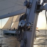Schooners sailing side by side at dusk