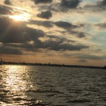 Sunset with rays of sun peaking through clouds over Annapolis