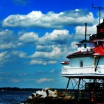 Thomas Point Lighthouse with bright blue sky and white clouds