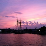 Annapolis skyline and water turned purple in sunset and silhouetting masts