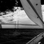Black and white photo from stern of schooner with Bay Bridge