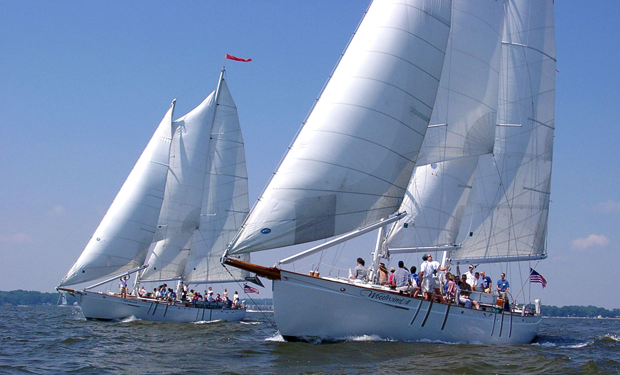 Both schooners under full sail side by side for a team building