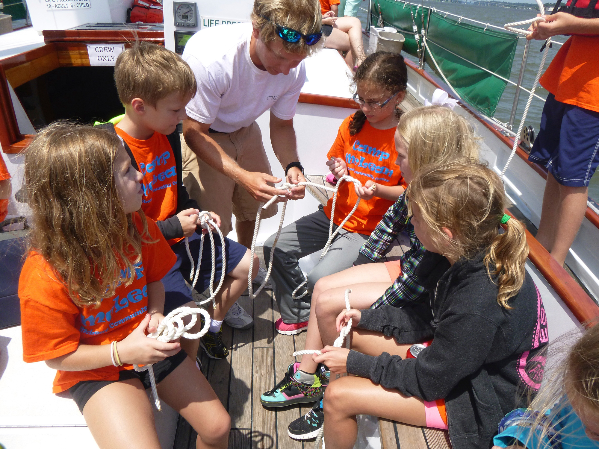 Student group on board learning to tie knots