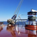 Polished wood and winch shining on a blue sunny day