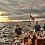 Sailing captain and crew with dramatic sky and waters around them