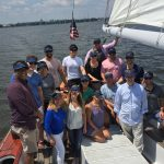 Company outing picture all have on black visors with blue print