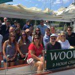 Smiling employee party aboard the Schooner