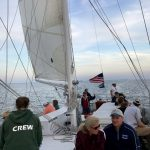 Guests and crew aboard the schooner on a windy day