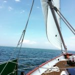 Looking out at beautiful blue sky and water from the schooner deck