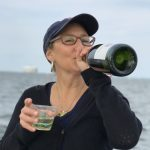Guest on schooner drinking out of bottle of wine