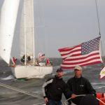 One schooner gaining ground on the first schooner on a windy day