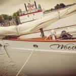 Bow of Schooner Woodwind with Annapolis Harbor Queen behind it