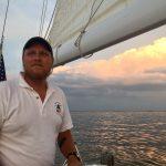 Captaining the schooner on a beautiful evening