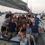 Large group of family and friends celebrating a birthday on board