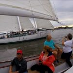 Both Schooners side by side with guests waving