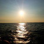 Sunset reflecting on dark blue waves of the Chesapeake Bay